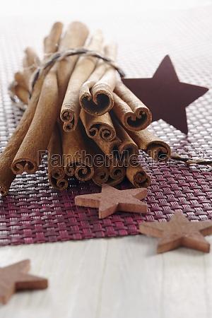 cinnamon sticks and wooden stars on