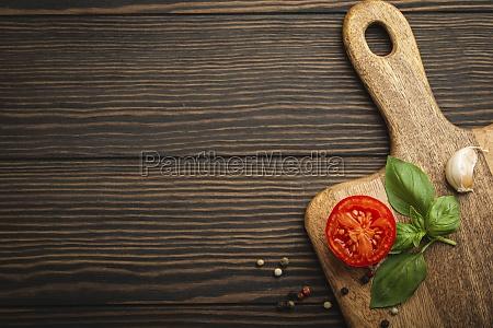 cutting board fresh tomato basil garlic