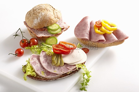 sliced sausage on bread rolls with