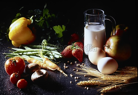still life with milk eggs fruits