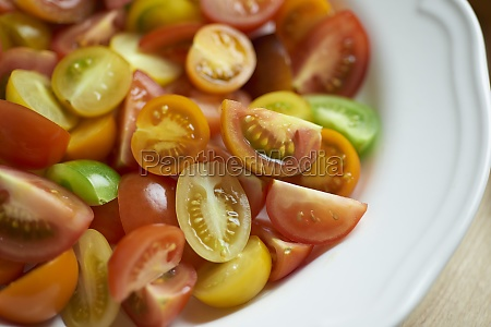colorful tomatoes halved and quartered on