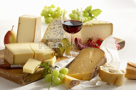 a still life of french cheeses