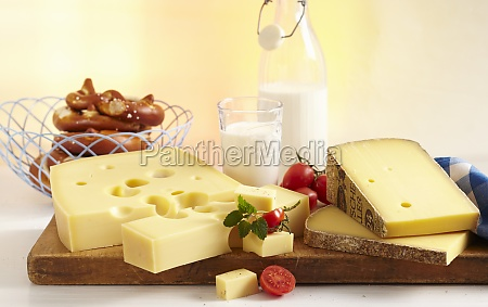 a cheese still life with pretzels