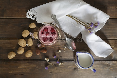 raspberry smoothie in glass jar with