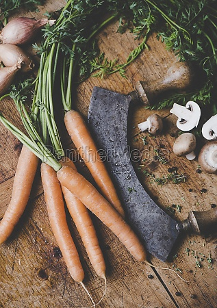carrots onions mushrooms and a chopping
