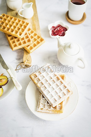crispy homemade waffles with icing sugar