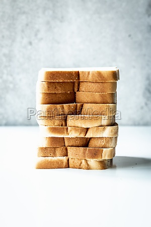 slices of white sliced bread stacked