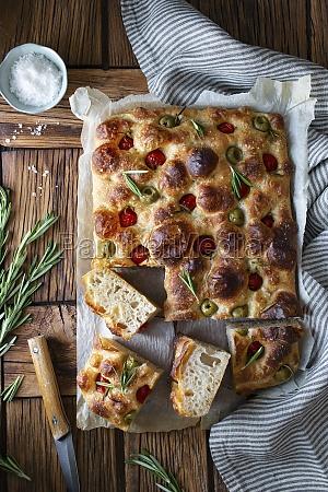 overhead potato focaccia with fresh rosemary