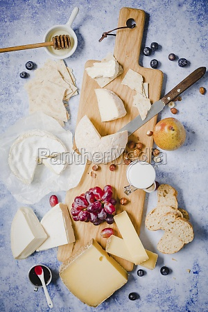 a cheese board with fruits bread