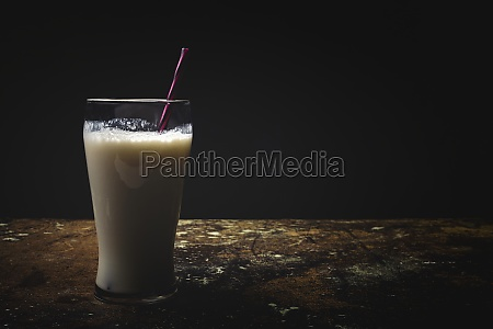 tall glass of white milk with