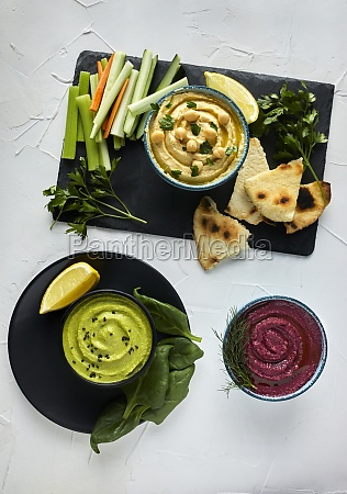 various types of hummus served with