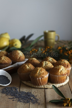 cupcakes on wicker stand on wooden