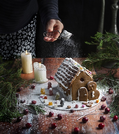 gingerbread house with icing sugar sprinkling