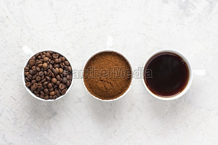coffee cups with coffee beans ground