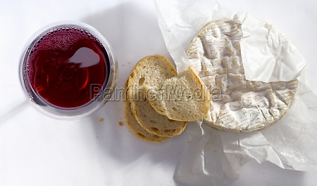 camembert with baguette and a glass