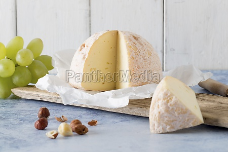 soft cheese on paper hazelnuts and