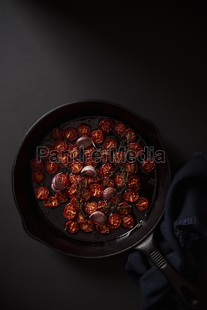 slow roaasted cherry tomatoes with garlic