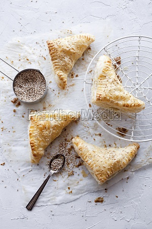 savory pastries with sprinkled sesame seeds