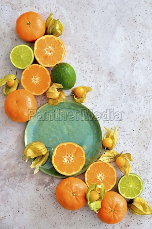 citruses and physalis arranged on a