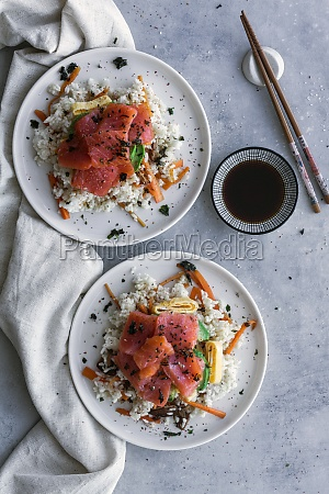 sliced salmon on white rice with