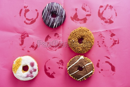 variety of doughnuts on pink background