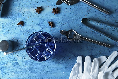 blue drink and bartender tools on