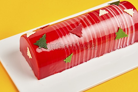 cake with red icing and christmas