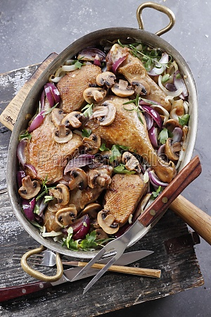pieces of chicken baked with mushrooms