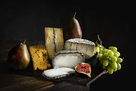 cheese selection with grapes figs and