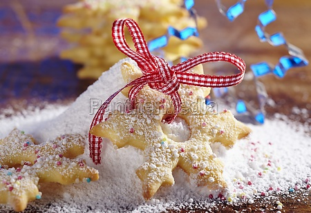 a shortbread snowflake biscuit with sugar
