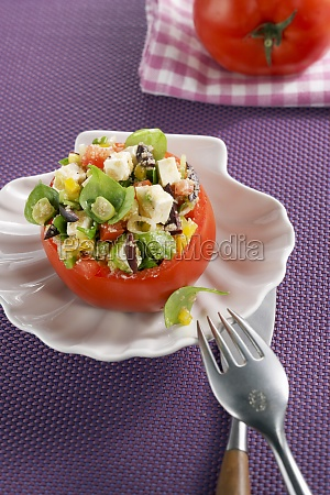 a tomato stuffed with amaranth and