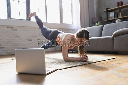 young woman follows with a laptop