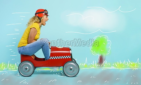 woman with red helmet drives a