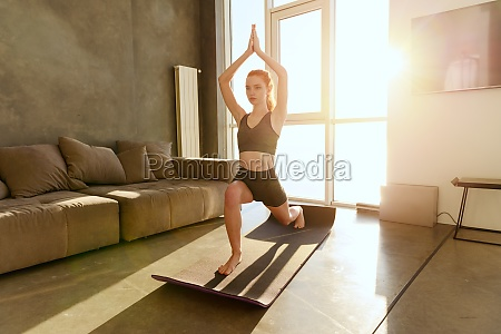 young girl relaxing in yoga position