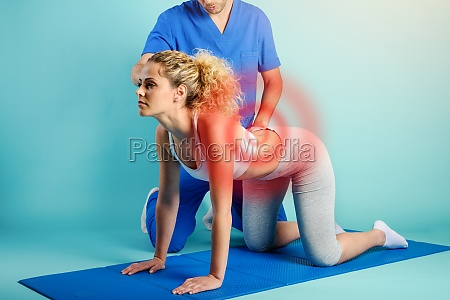 girl performs exercises with a physiotherapist