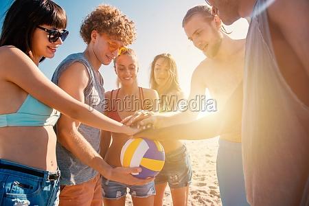 group of friends that play beachvolley