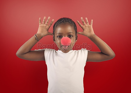 little girl makes grimace with red