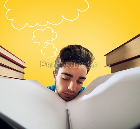 exhausted student is studying hard on