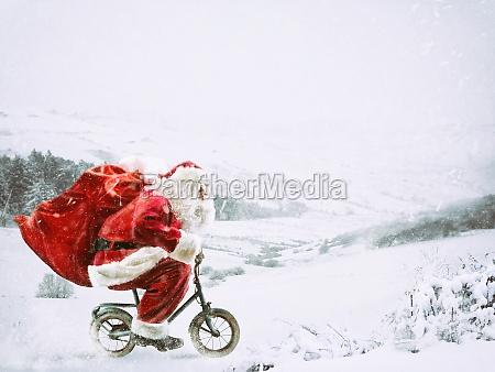 santa claus on a little bike