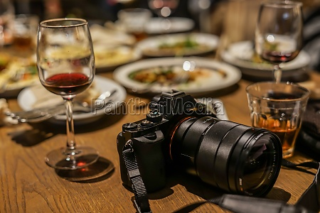 camera and wine glass
