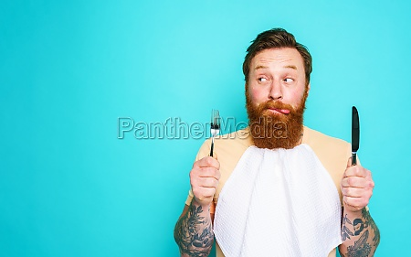 man with tattoos is ready to