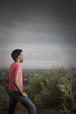 african american man walking in remote