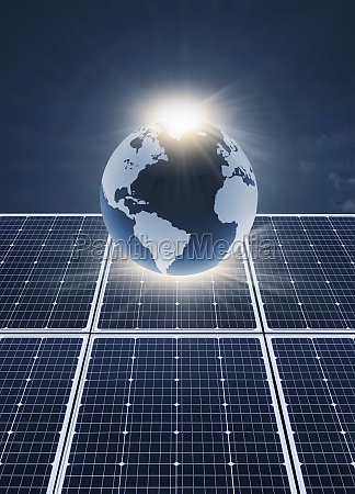 solar panels and globe against blue