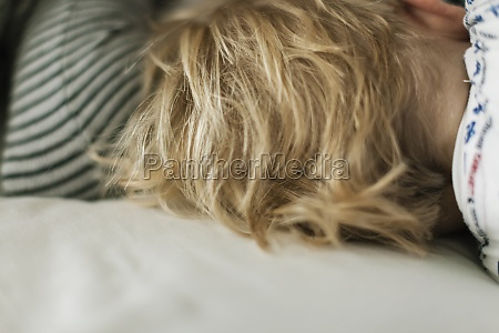blonde head of hair of sleeping