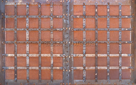 old rusted opaque metal gate with