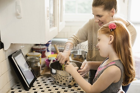 girl and mother looking at recipe