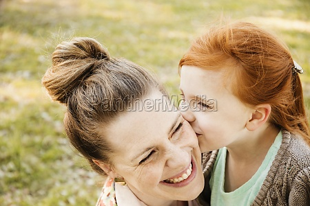 portrait of smiling mid adult mother