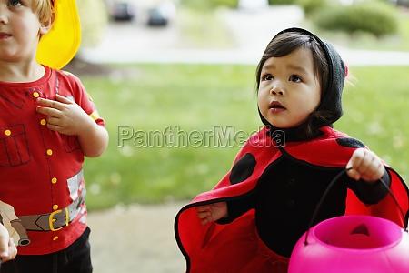 girl and boy wearing fancy dress