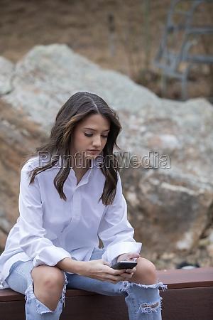 teenage 14 15 girl using mobile