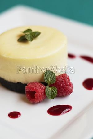 raspberry cheesecake with fresh raspberries and